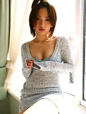 Ryoko Tanaka Asian shows leering curves in the window daylight