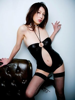Asian temptress taunts and teases in her red stripped lingerie