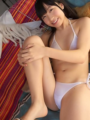 Hijiri Sachi Asian in shorts and bra enjoys sun on her curves
