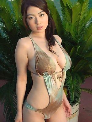 Petite gravure idol babe with big bouncy boobs in a skimpy bikini