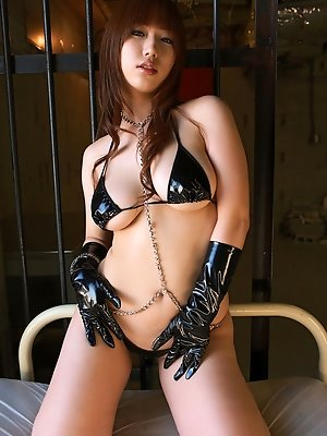 Cute asian school girl shows her naughty side in leather lingerie